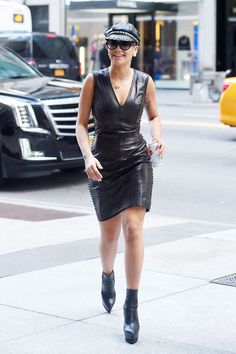 Rita Ora out in Manhattan in a tight leather dress in New York City on Aug. 12, 2015. - Cosmopolitan.com