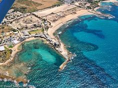 Caesarea, once a major seaport, is not to be confused with Caesarea Philippi in the north.