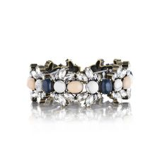 Chloe+Isabel Morningtide Stretch Bracelet $58  Chic meets casual in this versatile stretch bracelet. Semi-precious howlite, light pink, and navy cabochons are surrounded by clear crystal navettes for extra sparkle.  Easy to wear stretch style allows for an adjustable fit