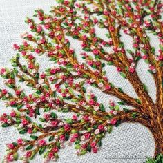 Hand embroidered tree with blossoms by Mary Corbet | The embroidery on the tree consists of three stitches: split stitch, straight stitch (or tiny seed stitches, sometimes doubled), and French knots.