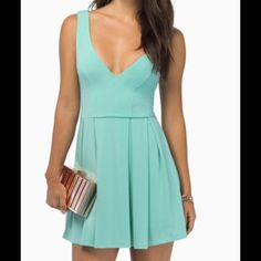 NEW!! Deep V Skater Dress The perfect dress for day or night! With plunging neckline and skater style this dress is sure to be a show stopper!! Tobi Dresses Mini