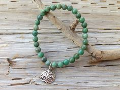 """$48 - AFRICN JADE TREE OF LIFE BRACELET    """"Change is inevitable. Growth is intentional."""" -Glenda Cloud  Green african jasper beads are accented with dangling sterling silver tree of life charm.  Stretch bracelet measures 7"""", sized to fit most wrists."""