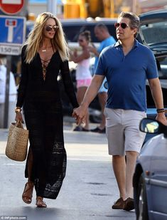 In love: The model and husband Jeffrey Soffer walk hand-in-hand, looking very much in love...