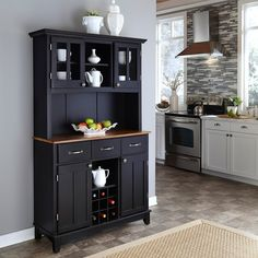 Keep your favorite dishes and serving pieces safe and easily organized with this black hutch buffet. The stylish wood hutch buffet provides ample room for storing and displaying prized pieces of china