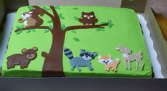 For the cake, I ordered just a plain sheet cake from Walmart and had them ice it in Green with a piped brown bottom border and I decorated it using gum paste to make the animals, tree leaves. Baby Girl Shower Themes, Baby Shower Parties, Baby Boy Shower, Baby Shower Decorations, Baby Shower Sheet Cakes, Baby Shower Cookies, Shower Cakes, 6th Birthday Parties, Baby First Birthday
