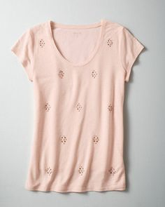 Our beaded tee shirt dazzles in a toned-down (and tonal) way. This classic, straight silhouette features antique-finish beads in muted neutrals. Versatile daytime-to-date-night glamour.