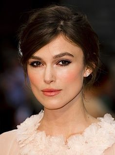 Keira Knightly's soft up-do complements strong brows, smokey brown eyes and pink/peach tones on cheeks and lips.  Wearing Chanel Couture at the 2012 premiere of Anna Karenina.