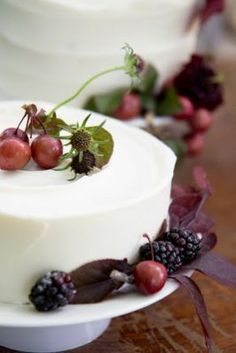 I really like the use of natural elements and the field of focus. Dark red cherries and rich blackberries top a simple buttercream cake.