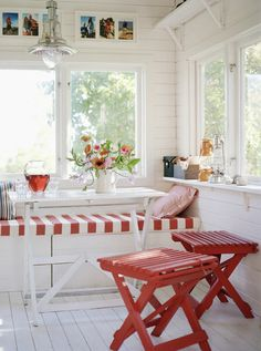 I absolutely love this red & white theme for a porch. A perfect summer look! -Maura