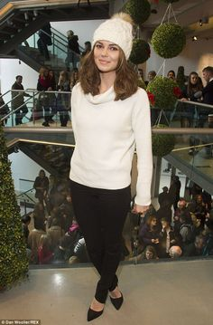 Showing her shape: Kara paired her knits with cigarette cut trousers and heels to show off...