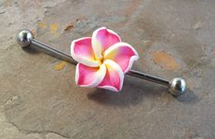 Pink Hawaiian flower industrial bar barbell piercing for your upper ear. Made from 316L surgical steel, the piercing is the same grade steel you would get from a piercing studio. This industrial barbe