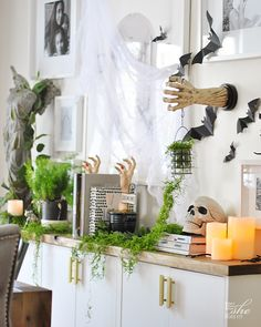 Haunted Table Setting and sideboard in dining room. Halloween Table Settings, Halloween Decorations, Decorating Your Home, Interior Decorating, Wood Bark, White Pumpkins, Candlestick Holders, Acacia Wood, Better Homes