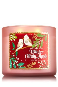 "Winter Candy Apple - 3-Wick Candle - Bath & Body Works - The Perfect 3-Wick Candle! Made using the highest concentration of fragrance oils, an exclusive blend of vegetable wax and wicks that won't burn out, our candles melt consistently & evenly, radiating enough fragrance to fill an entire room. Topped with a flame-extinguishing lid! Burns approximately 25 - 45 hours and measures 4"" wide x 3 1/2"" tall."