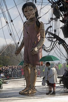 The Little Girl Giant marionette takes a shower before starting her journey through the streets of Liverpool as the Titanic Sea Odyssey giant puppet spectacular gets underway on April 20, 2012 in Liverpool, England. Over the next three days French street theatre company Royal De Luxe will be performing Sea Odyssey with the giants coming to life telling a story inspired by The Titanic.