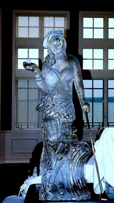. femal golfer ice sculpture
