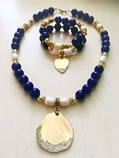 Navy blue, fresh water pearl and gold beads necklace and bracelet...