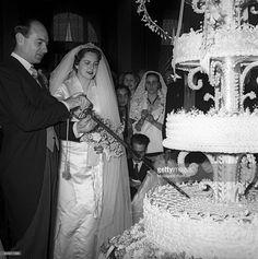 Italian Princess Maria Pia of Savoy and her husband the Prince Alexander Karadordevic of Yugoslavia cutting their wedding cake. Cascais, February 1955 Get premium, high resolution news photos at Getty Images