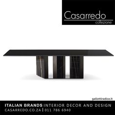 The impressive Platium Dining Table has a glass top and features a stunning base. The table is designed by Oscar & Gabriele Buratti for Gallotti & Radice and is part of our 2016 luxury contemporary furniture collection made in Italy.  The Platium table top is 15mm painted black glass or can be painted in the satin version. There is a 4cm bevel on the two shorter edges. The base is 136.2cm wide and is made from Sahara Noir marble that is slotted in between sections of super mirror.  Exclusive…