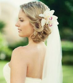 beach wedding hairstyle with flowers and veil