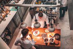 Chefs preparing dinner at Eska restaurant in Prague
