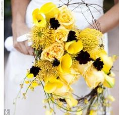 Yellow Themed Wedding Bouquets    Tim- I don't like it. It looks like a bird's nest... I could lie and tell you that I like it. But I don't.