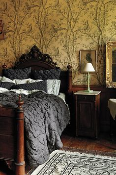 vintage wallpaper, antique walnut head & foot board, antique wooden night stand with beautiful, luxury modern linens, pillows & comforter!