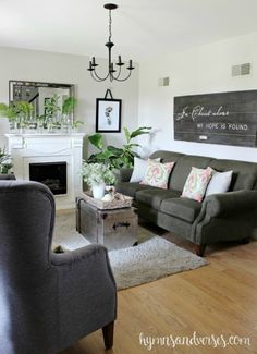 Love this home tour with cozy living room with gray sofa and chairs and DIY reclaimed wood sign eclecticallyvintage.com