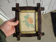 http://www.ebay.com/itm/Excellent-Antique-19thC-Folk-Art-Carved-Frame-with-Friendship-Token-Theorem-/252736537921?hash=item3ad8458541:g:QTUAAOSwA3dYZDpr