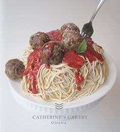 Spaghetti cake - The spaghetti is fondant, the meatballs are cake covered in fondant and painted with food colouring, the tomato sauce is pureed strawberries, the leaves are gum paste, the parmesan is grated gum paste.
