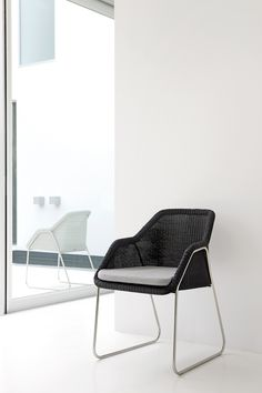 Lightweight outdoor dining chair - MOOD collection by Manutti. Wicker. Contemporary meets classic.