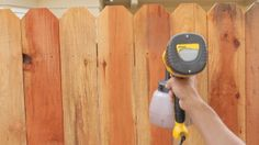 Improve the appearance of your fence and protect the wood in the process with a fresh coat of stain.  Here's how to easily tackle the job yourself. #ProjectsMadeSimple