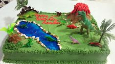 Dinosaurs 1/2 sheet cake - 1/2 chocolate w/banana cream filling. 1/2 orange cake with pineapple filling.