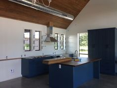 Austin architect, Erica Heroy, design. Look at the exposed ducts.  We love them.  Just wonder what they add to the price.