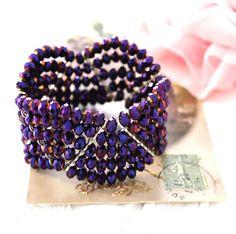Bracelet  manchette Violette mon amour, orné de 5 rangées de cristal de bohême violet, il donnera une note très chic et très glamour à toutes vos tenues-29 euros