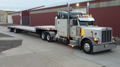 Rolland Johnson's 2001 Peterbilt 379 features custom graphics in honor of his black lab.