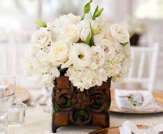 Beautiful flower arrangement-dark earthy wood with white delicate flowers.  Eureka Springs,AR