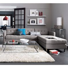 dual pebble tufted sectional in sofas | CB2