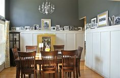 love this dining room - paint color, curtains and yellow china cabinet
