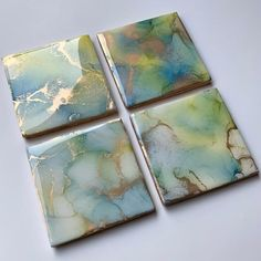 """Abstract art coaster set. Alcohol ink on 4"""" x 4"""" square ceramic tiles, varnished and UV protected, coated in glossy resin, and backed with cork. Golden edges. You may not receive the exact set depicted in the photos, but rather a unique, handmade version in the same colors and style. This is an original, one-of-a-kind, abstract art painted home accessory. Intended for use with hot and cold beverages, but may also be displayed as decorative tiles. Please handle with care - do not submerge in wate Alcohol Ink Tiles, Alcohol Ink Crafts, Alcohol Ink Painting, Epoxy Resin Art, Resin Crafts, Diy Crafts, Acrylic Pouring Art, Decorative Tile, Art Techniques"""