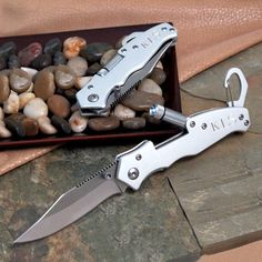 FREE ENGRAVING TODAY Never get caught in the dark again with our Personalized Pocket Knife with Flashlight tucked in your backpack or jacket pocket. Whether your are extreme camping, cave spelunking, rock climbing or just taking an easy road trip, this knife-light combo will get you out of many a bind. A unique and useful tool that can be presented as groomsmen gifts for the men who have been more than utilitarian in your life