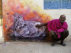 by the artist C215 (Christian Guerny) who travels the world sharing his art via stencils on the wall