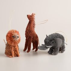 Trim your tree in safari style with our lion, giraffe and elephant ornaments, handcrafted in the Philippines of richly textured buri and accented with twigs.