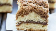 Cinnamon Crumb Coffee Cake with a thick cinnamon streusel topping over fluffy, buttery cake, and a ribbon of melty cinnamon through the center.