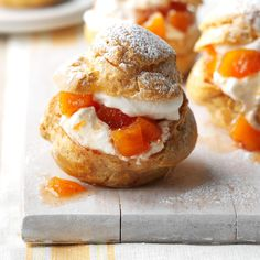 Peach Cream Puffs Recipe -On a sizzling day, we crave something light, airy and cool. Nothing says summer like cream puffs stuffed with peaches and whipped cream. —Angela Benedict, Dunbar, West Virginia