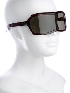 7b636e996e Brown tortoiseshell acetate Maison Martin Margiela sunglasses with tinted  lenses and silver-tone hardware. Includes case and box.