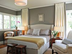 Grey and Yellow Traditional Bedroom I desperately want to paint our bedroom gray and I love this toned-down take on the gray and yellow trend, with muted shades of cream and gold warming up the gray.