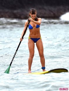 Looking for a fun workout while on vacation?  Give paddle boarding a try.