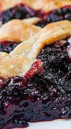 The best blackberry pie EVER. No kidding! All butter crust The best blackberry pie ever. No kidding! All butter crust, loads of blackberries, spiced with a little lemon, cinnamon, and almond extract. Blackberry Pie Fillings, Blackberry Pie Recipes, Recipe For Blackberry Pie Filling, Blackberry Dessert, Pie Dessert, Dessert Recipes, Just Desserts, Delicious Desserts, Butter Crust