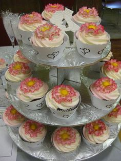 Red Velvet Cupcakes. - Decorations are made of fondant and they are dressed with cupcake wrappers.
