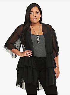 "This black kimono is a lightweight to wrap up in but it's no lightweight on stylish detail. Layers of ruffles. Asymmetrical hem. Satin stitching. It sounds like a heavyweight fashion statement to us.<ul><li> Size 1 measures 36 7/8"" from shoulder</li><li>Polyester</li><li>Wash cold, dry low</li><li>Made in USA</li></ul>"